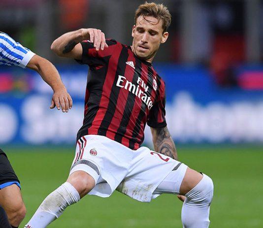 Lucas Biglia and Eros Schiavon during Milan-SPAL at Stadio San Siro on September 20, 2017. (MARCO BERTORELLO/AFP/Getty Images)