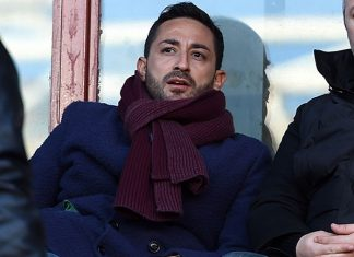 Giuseppe Riso (L) and Vladica Lemić during Genoa-Palermo at Stadio Luigi Ferraris on January 17, 2016. (Photo by Tullio M. Puglia/Getty Images)