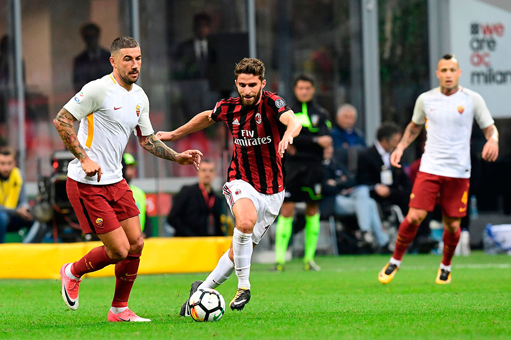 Fabio Borini, Aleksandar Kolarov and Radja Nainggolan during Milan-Roma at Stadio San Siro on October 1, 2017. (MIGUEL MEDINA/AFP/Getty Images)