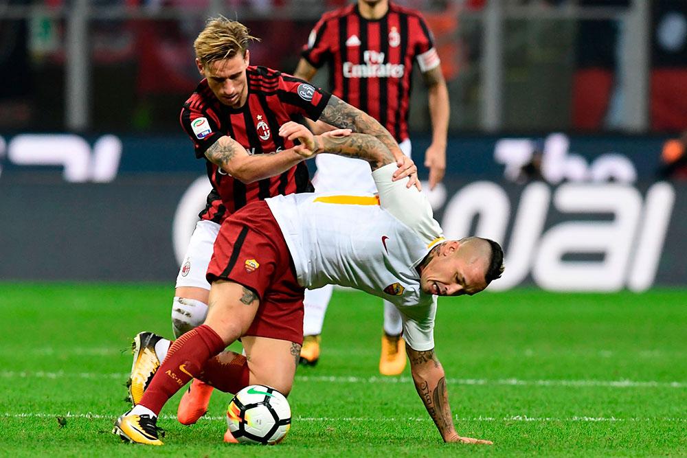 Lucas Biglia and Radja Nainggolan during Milan-Roma at Stadio San Siro on October 1, 2017. (MIGUEL MEDINA/AFP/Getty Images)