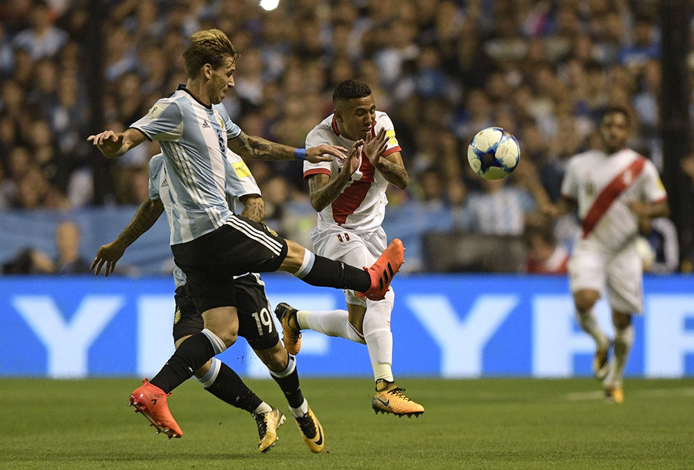 Lucas Biglia and Sergio Pena during the Argentina-Peru FIFA 2018 World Cup qualifier ar La Bombonera on October 5, 2017 in Buenos Aires, Argentina. (JUAN MABROMATA/AFP/Getty Images)