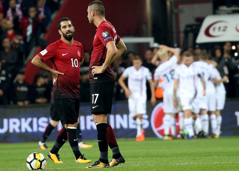 Arda Turan and Burak Yilmaz during the Turkey-Iceland FIFA 2018 World Cup qualifier on October 6, 2017 at the Eskisehir Stadium in Eskisehir, Turkey. (STR/AFP/Getty Images)