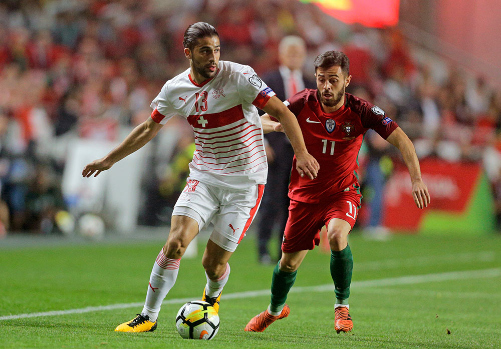Ricardo Rodriguez and Bernardo Silva during the Portugal-Switzerland FIFA World Cup 2018 qualifier at the Luz Stadium on October 10, 2017 in Lisbon, Portugal. (JOSE MANUEL RIBEIRO/AFP/Getty Images)