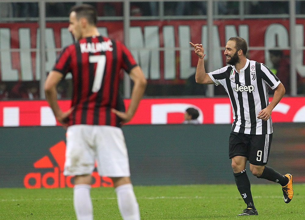Gonzalo Higuain celebrating during Milan-Juventus at Stadio San Siro on October 28, 2017. (MARCO BERTORELLO/AFP/Getty Images)