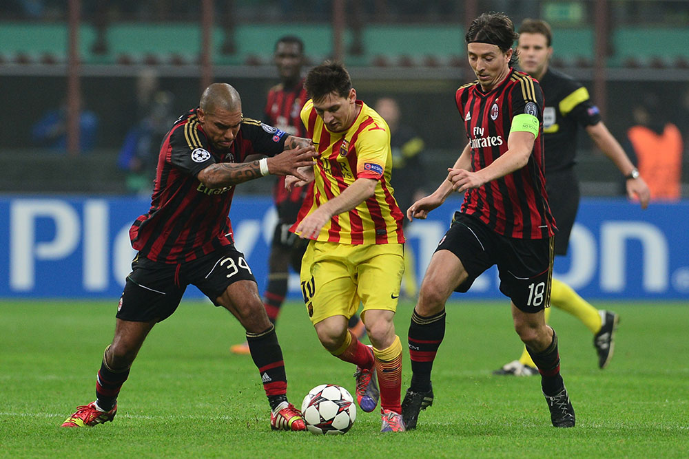 Riccardo Montolivo, Nigel De Jong and Lionel Messi during Milan-Barcelona at Stadio San Siro on October 22, 2013. (GIUSEPPE CACACE/AFP/Getty Images)