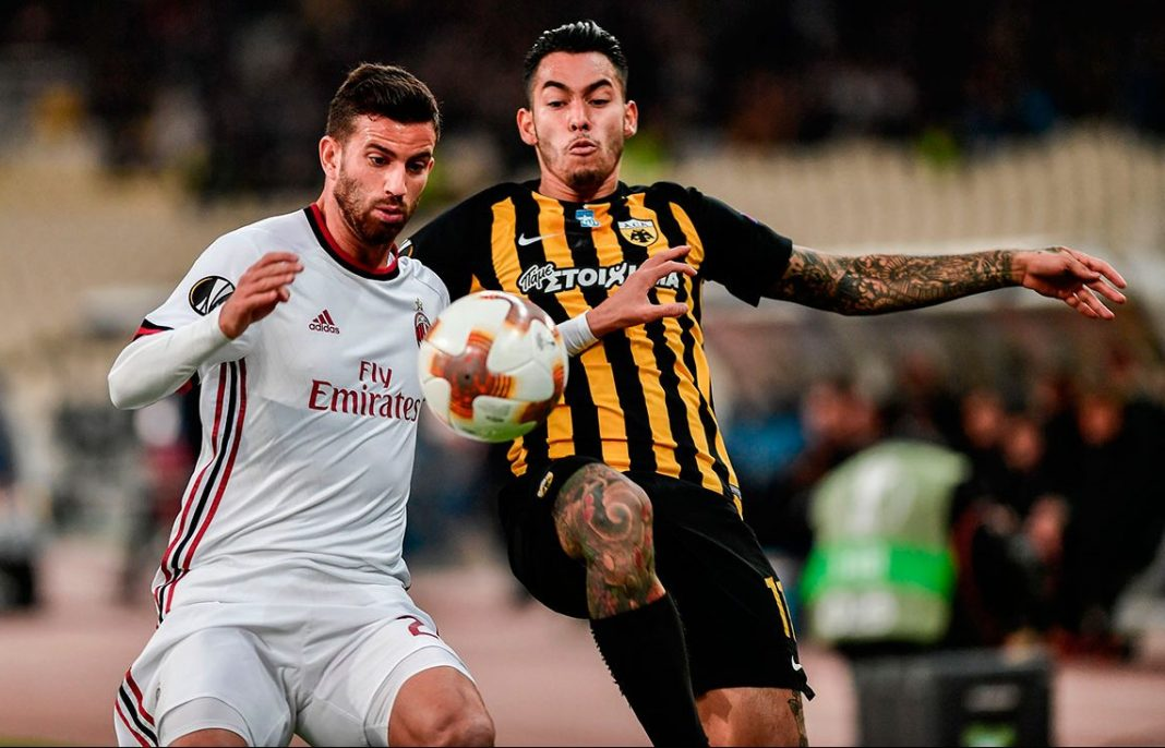 Mateo Musacchio and Sergio Araujo during AEK Athens-Milan at Athens Olympic Stadium on November 2, 2017. (LOUISA GOULIAMAKI/AFP/Getty Images)