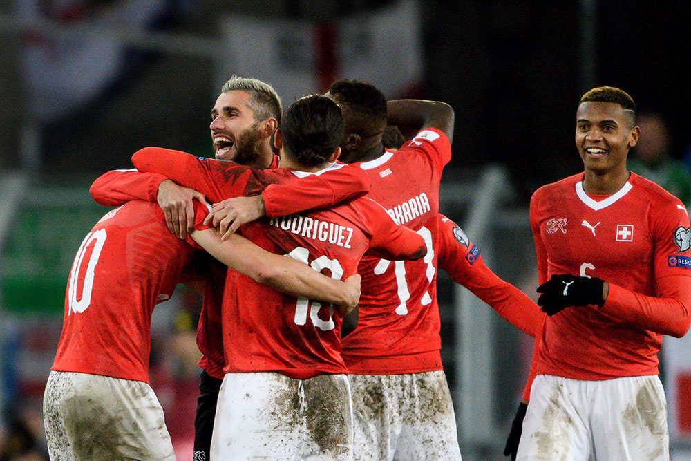 Ricardo Rodriguez celebrating with his Switzerland teammates at the end of the Switzerland-Northern Ireland at St. Jakob-Park Stadium on November 12 2017 in Basel, Switzerland. (FABRICE COFFRINI/AFP/Getty Images)