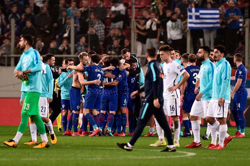 Croatia players celebrating at the end of the Greece-Croatia FIFA 2018 World Cup Qualifier Play-Off second leg at Karaiskakis Stadium on November 12 2017, in Piraeus, Greece. (ANGELOS TZORTZINIS/AFP/Getty Images)