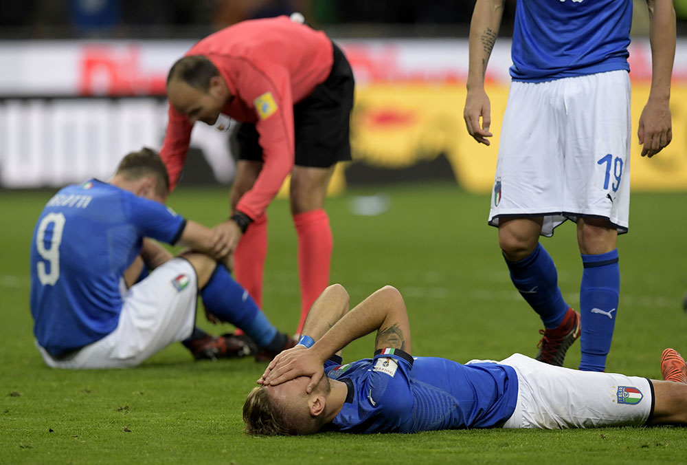 Andrea Belotti, Ciro Immobile and Leonardo Bonucci at the end of the end of the Sweden-Italy FIFA 2018 World Cup Qualifier Play-Off second leg at Stadio San Siro on November 13, 2017 in Milan, Italy. (MIGUEL MEDINA/AFP/Getty Images)