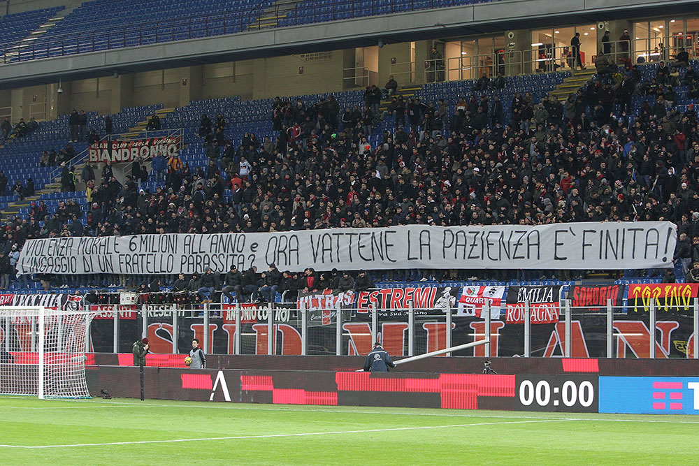 """The Curva Sud's displaying a banner against Donnarumma during Milan-Hellas at Stadio San Siro on December 13, 2017: """"Moral violence, 6 million per year and your parasite brother? Now go away, the patience is over."""" (Photo by Marco Luzzani/Getty Images)"""