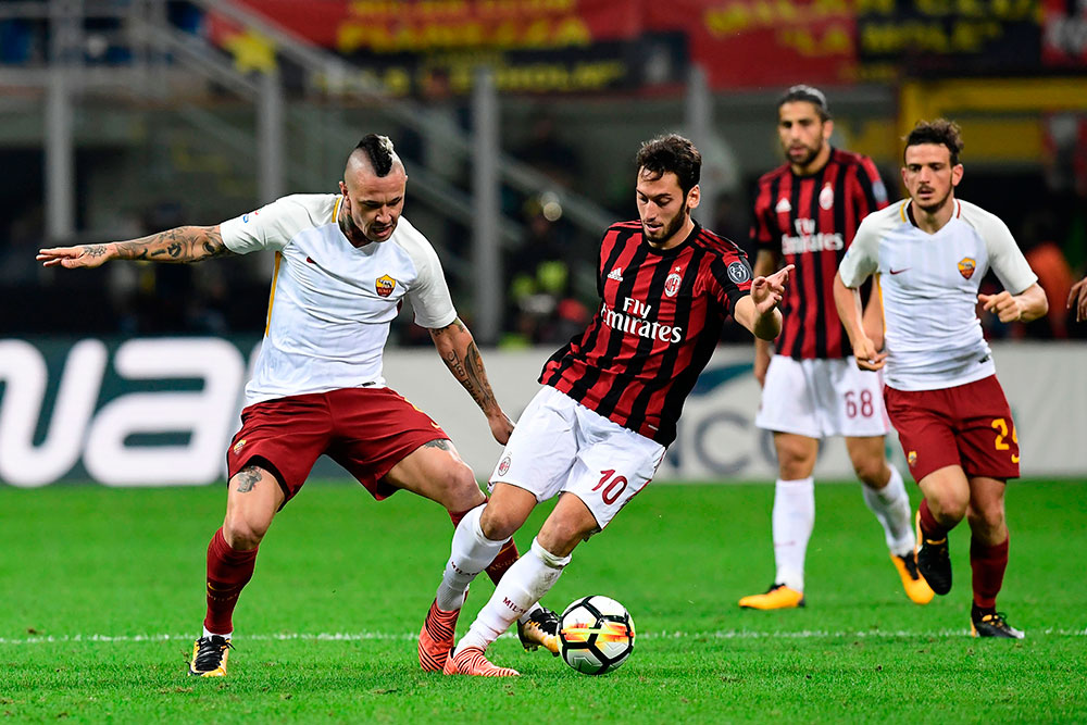 Hakan Çalhanoğlu and Radja Nainggolan during Milan-Roma at Stadio San Siro on October 1, 2017. (MIGUEL MEDINA/AFP/Getty Images)