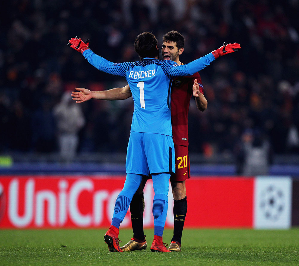 Alisson Becker and Fazio celebrating during Roma-Qarabag at Stadio Olimpico on December 5, 2017. (Photo by Paolo Bruno/Getty Images)