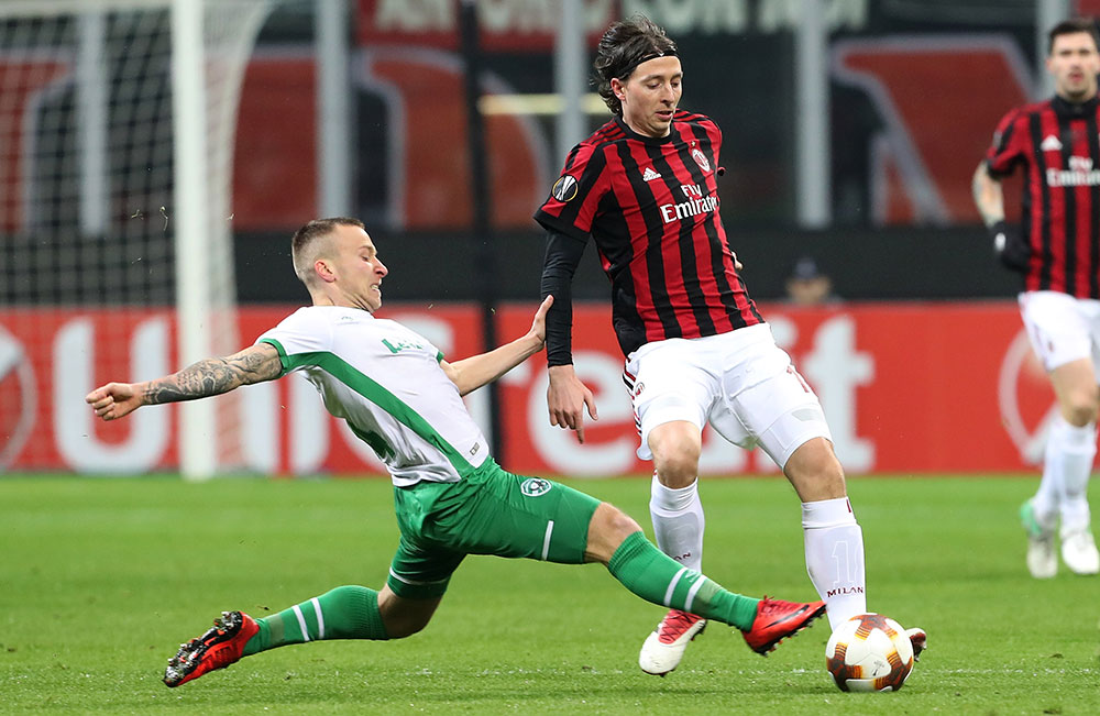 Riccardo Montolivo and Jacek Góralski during Milan-Ludogorets at Stadio San Siro on February 22, 2018. (Photo by Marco Luzzani/Getty Images)