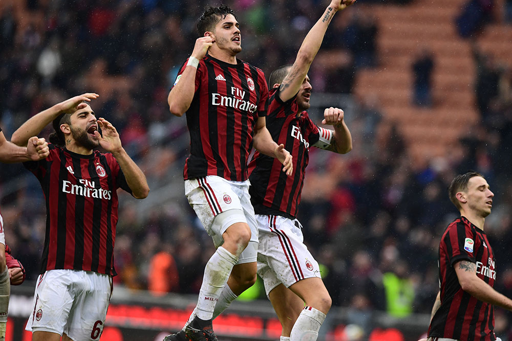 André Silva celebrating with Ricardo Rodriguez, Leonardo Bonucci and Lucas Biglia at the end of Milan-Chievo at Stadio San Sro on March 18, 2018. (MIGUEL MEDINA/AFP/Getty Images)