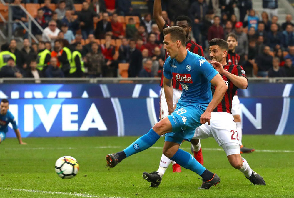 Arkadiusz Milik and Mateo Musacchio during Milan-Napoli at Stadio San Siro on April 15, 2018. (Photo by Marco Luzzani/Getty Images)