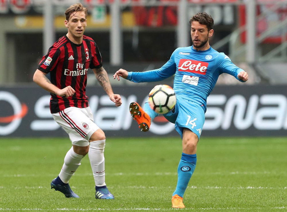 Lucas Biglia and Dries Mertens during Milan-Napoli at Stadio San Siro on April 15, 2018. (Photo by Marco Luzzani/Getty Images)
