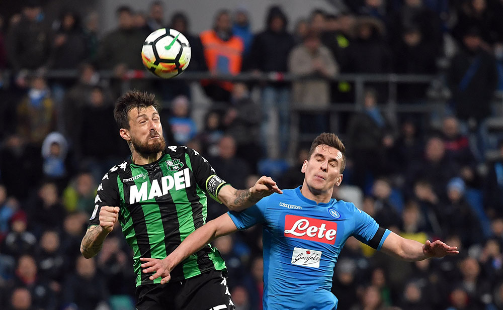 Francesco Acerbi and Arkadiusz Milik during Sassuolo-Napoli at Mapei Stadium – Città del Tricolore on March 31, 2018. (TIZIANA FABI/AFP/Getty Images)