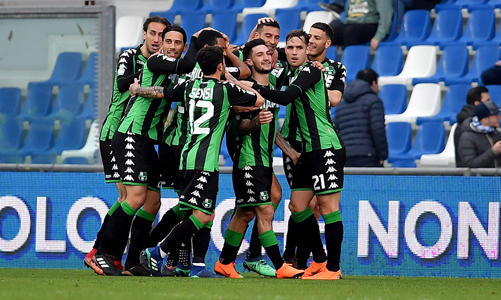 Sassuolo players celebrating during Sassuolo-Napoli at Mapei Stadium – Città del Tricolore on March 31, 2018. (TIZIANA FABI/AFP/Getty Images)