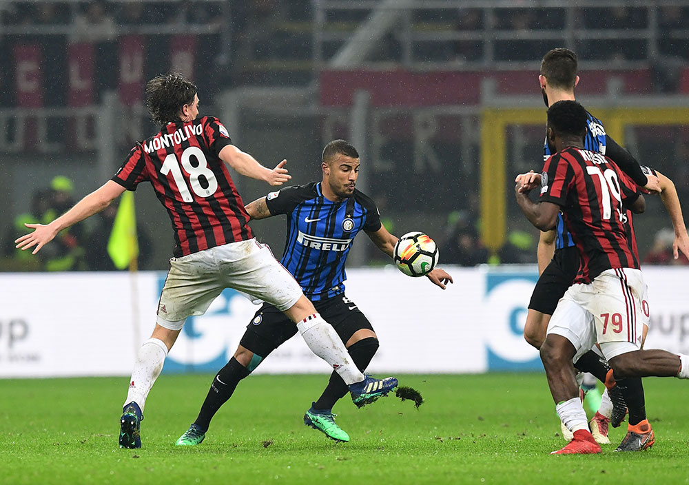 Riccardo Montolivo and Rafinha during Milan-Inter at Stadio San Siro on April 4, 2018. (Photo by Marco Luzzani/Getty Images)