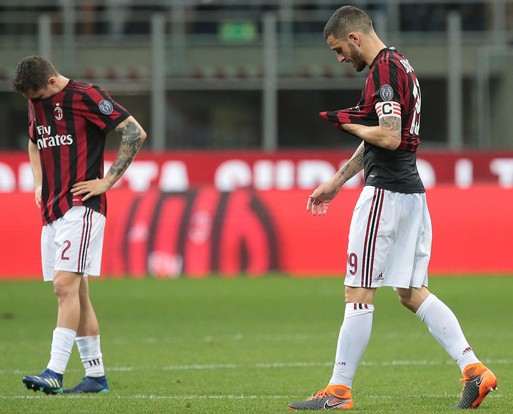 Leonardo Bonucci and Davide Calabria at the end of Milan-Benevento at Stadio San Siro on April 21, 2018. (Photo by Emilio Andreoli/Getty Images)
