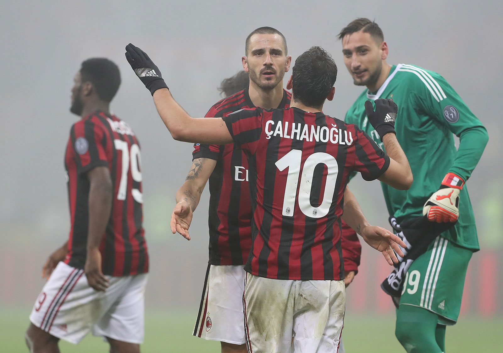 Hakan Çalhanoğlu, Leonardo Bonucci and Gianluigi Donnarumma celebrating at the end of Milan-Lazio at Stadio San Siro on January 28, 2018.  (Photo by Marco Luzzani/Getty Images)