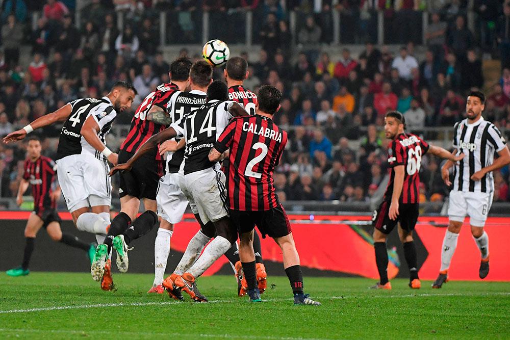 Medhi Benatia scoring during Juventus-Milan at Stadio Olimpico on May 9, 2018. (TIZIANA FABI/AFP/Getty Images)