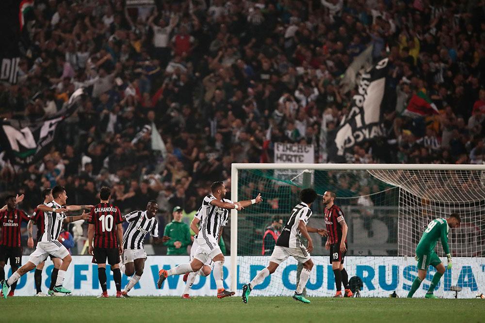 Medhi Benatia celebrating during Juventus-Milan at Stadio Olimpico on May 9, 2018. (ISABELLA BONOTTO/AFP/Getty Images)