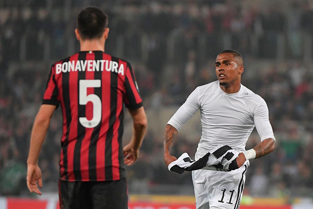 Douglas Costa celebrating during Juventus-Milan at Stadio Olimpico on May 9, 2018. (TIZIANA FABI/AFP/Getty Images)