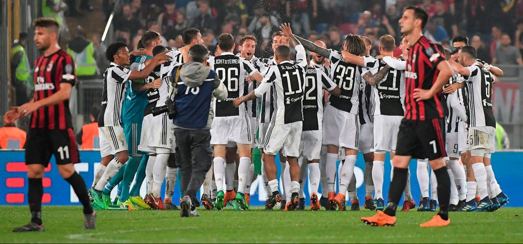 Juventus players celebrating at the end of Juventus-Milan at Stadio Olimpico on May 9, 2018. (TIZIANA FABI/AFP/Getty Images)
