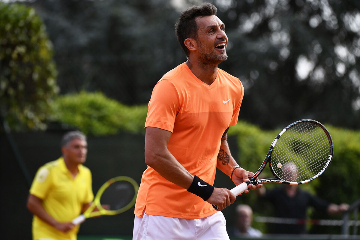 Paolo Maldini during the men's doubles tennis match, with his partner Stefano Landonio against Poland's player Tomasz Bednarek and Nederland's player David Pel during the ATP Challenger Tour on June 27, 2017 at the Aspria Tennis Club in Milan. (MARCO BERTORELLO/AFP/Getty Images)