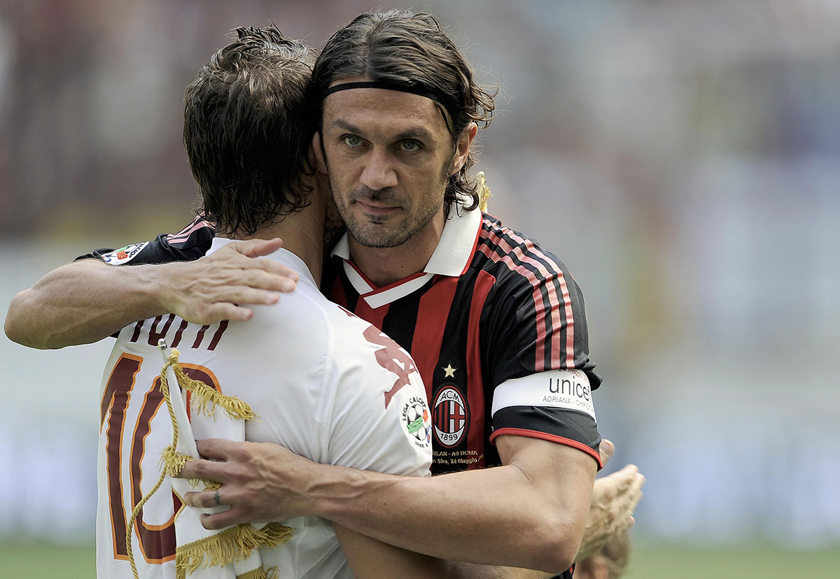 Paolo Maldini and Francesco Totti hugging before Milan-Roma at Stadio San Siro on May 24, 2009. (FILIPPO MONTEFORTE/AFP/Getty Images)