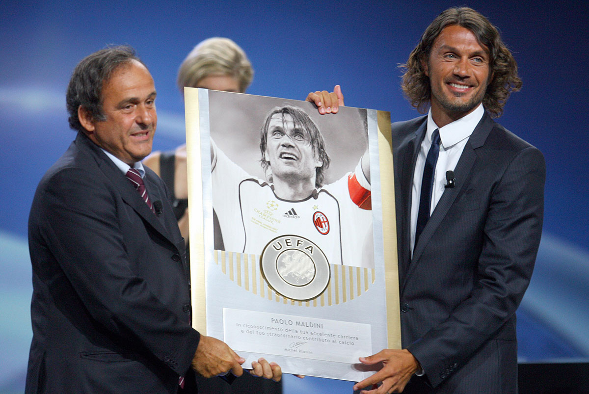 Michel Platini awarding Paolo Maldini with a special award for his career during the 2009/2010 European Champions League groups stage draw on August 27, 2009, in Monaco. (STEPHANE DANNA/AFP/Getty Images)