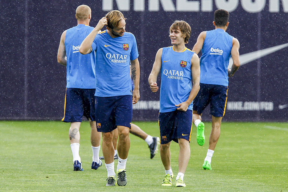 Alen Halilović and Ivan Rakitić during training at the Sports Center FC Barcelona Joan Gamper in Sant Joan Despi, near Barcelona on August 13, 2015. (QUIQUE GARCIA/AFP/Getty Images)
