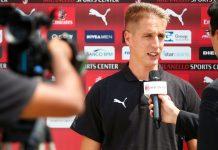 Andrea Conti talking to MilanTV on July 11, 2018. (@acmilan.com)