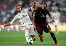 Gonzalo Higuain and Sergio Ramos during Real Madrid-Milan at Estadio Santiago Bernabéu on August 11, 2018. (GABRIEL BOUYS/AFP/Getty Images)