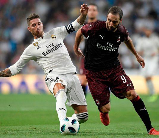 Gonzalo Higuain and Sergio Ramos during Real Madrid-Milan at Estadio Santiago Bernabéu on August 11, 2018. (GABRIEL BOUYS/AFP/Getty Images)