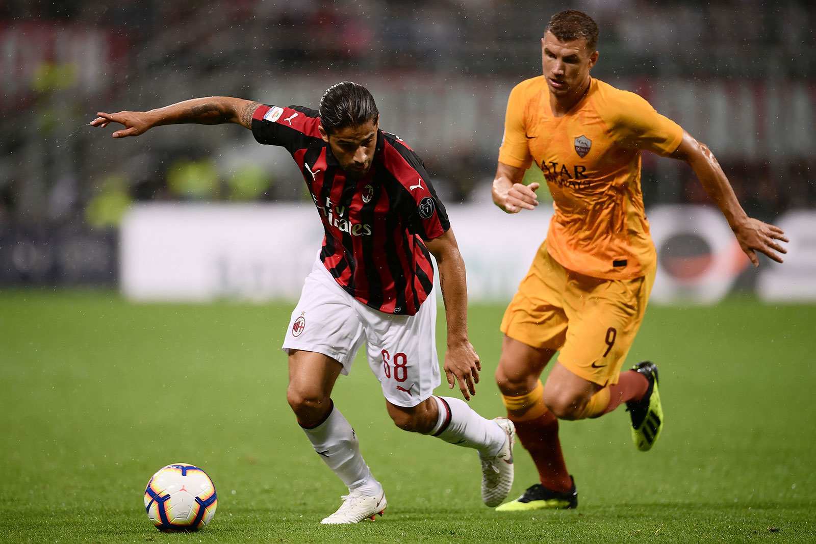 Ricardo Rodriguez and Edin Džeko during Milan-Roma at Stadio San Siro on August 31, 2018. (MARCO BERTORELLO/AFP/Getty Images)