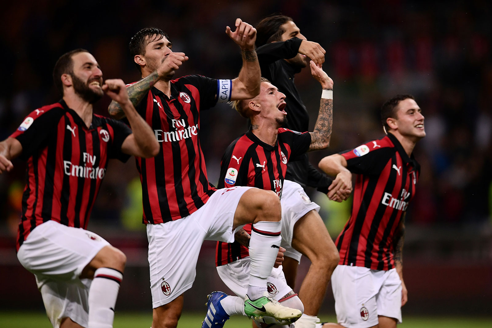 Gonzalo Higuain, Alessio Romagnoli, Samu Castillejo, Ricardo Rodriguez and Davide Calabria celebrating at the end of Milan-Roma at Stadio San Siro on August 31, 2018. (MARCO BERTORELLO/AFP/Getty Images)