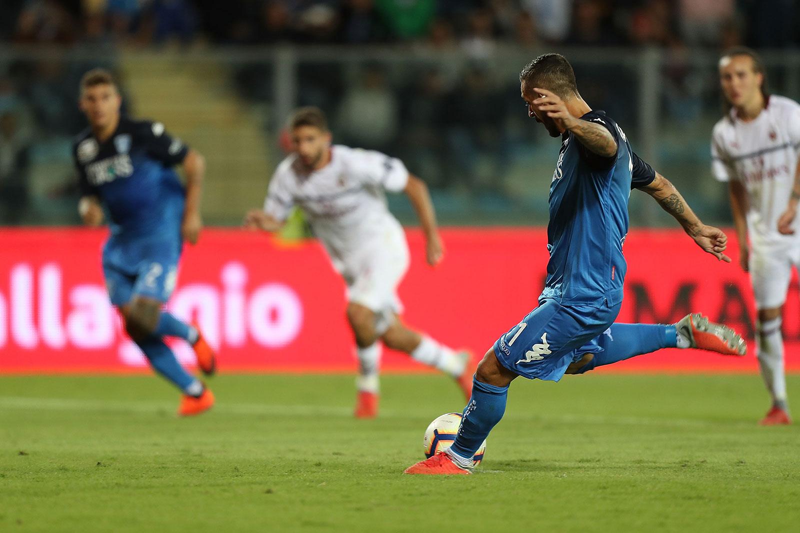 Francesco Caputo scoring a penalty during Empoli-Milan at Stadio Carlo Castellani on September 27, 2018. (Photo by Gabriele Maltinti/Getty Images)
