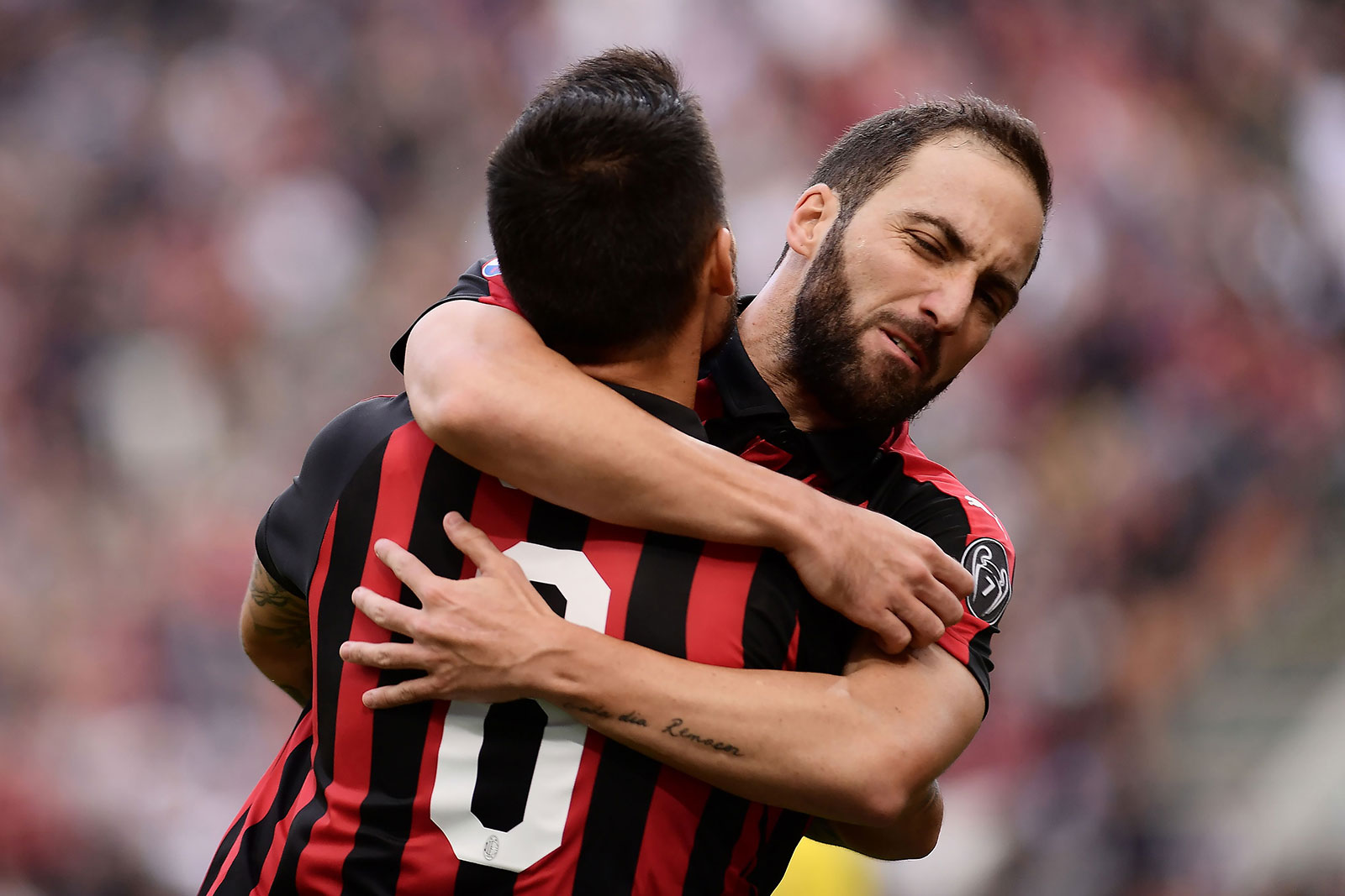 Gonzalo Higuain and Suso celebrating during Milan-Chievo at Stadio San Siro on October 7, 2018. (MARCO BERTORELLO/AFP/Getty Images)