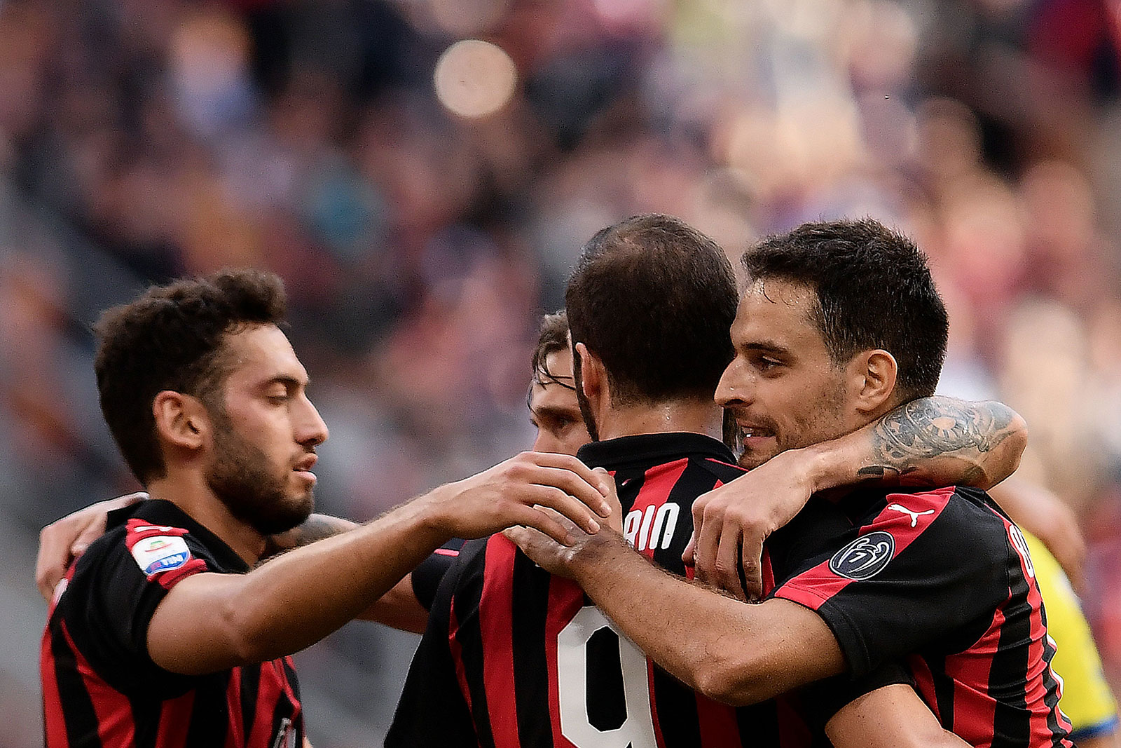 Giacomo Bonaventura, Gonzalo Higuain and Hakan Çalhanoğlu celebrating during Milan-Chievo at Stadio San Siro on October 7, 2018. (MARCO BERTORELLO/AFP/Getty Images)