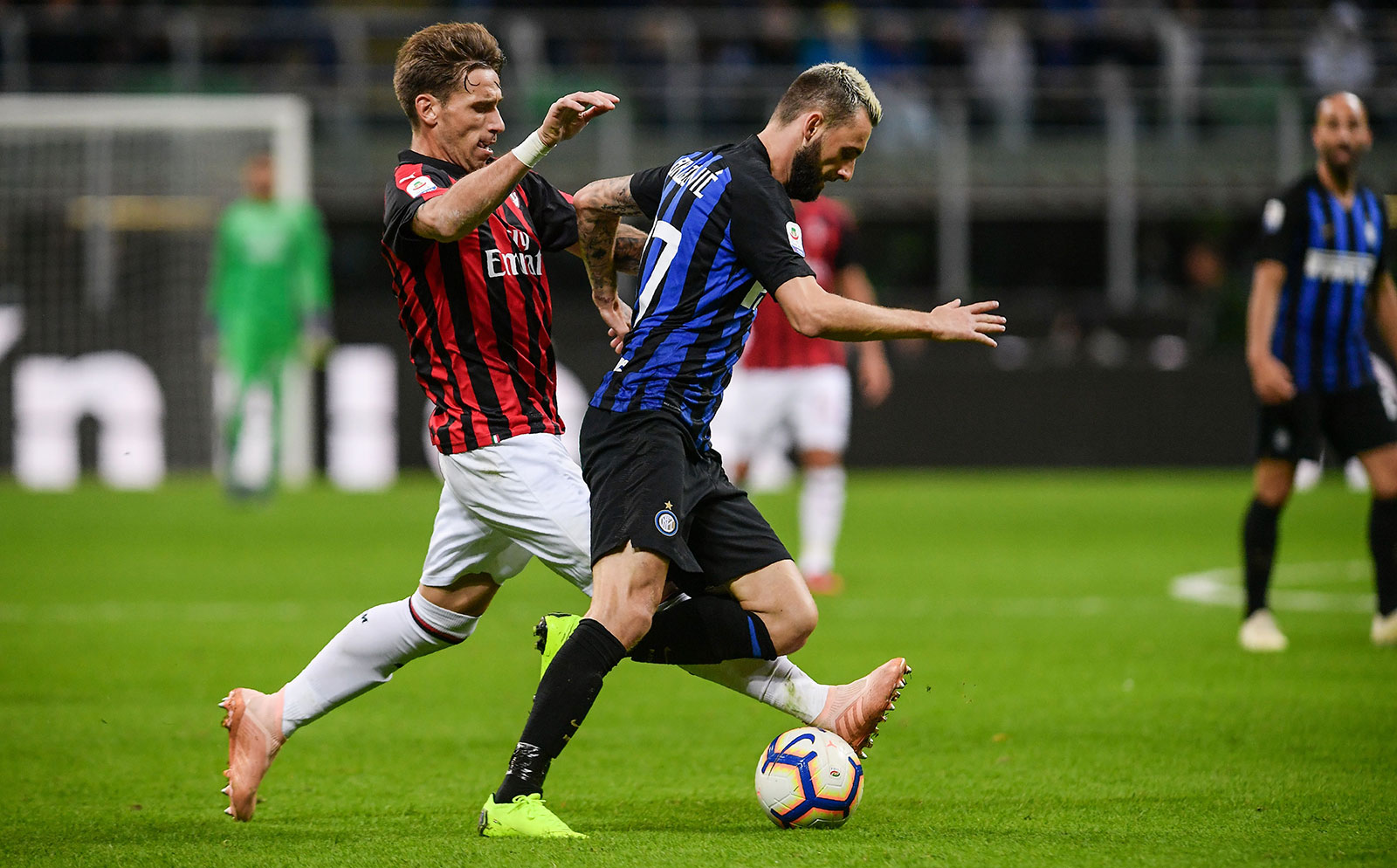 Lucas Biglia and Marcelo Brozović during Inter-Milan at Stadio San Siro on October 21, 2018. (MARCO BERTORELLO/AFP/Getty Images)