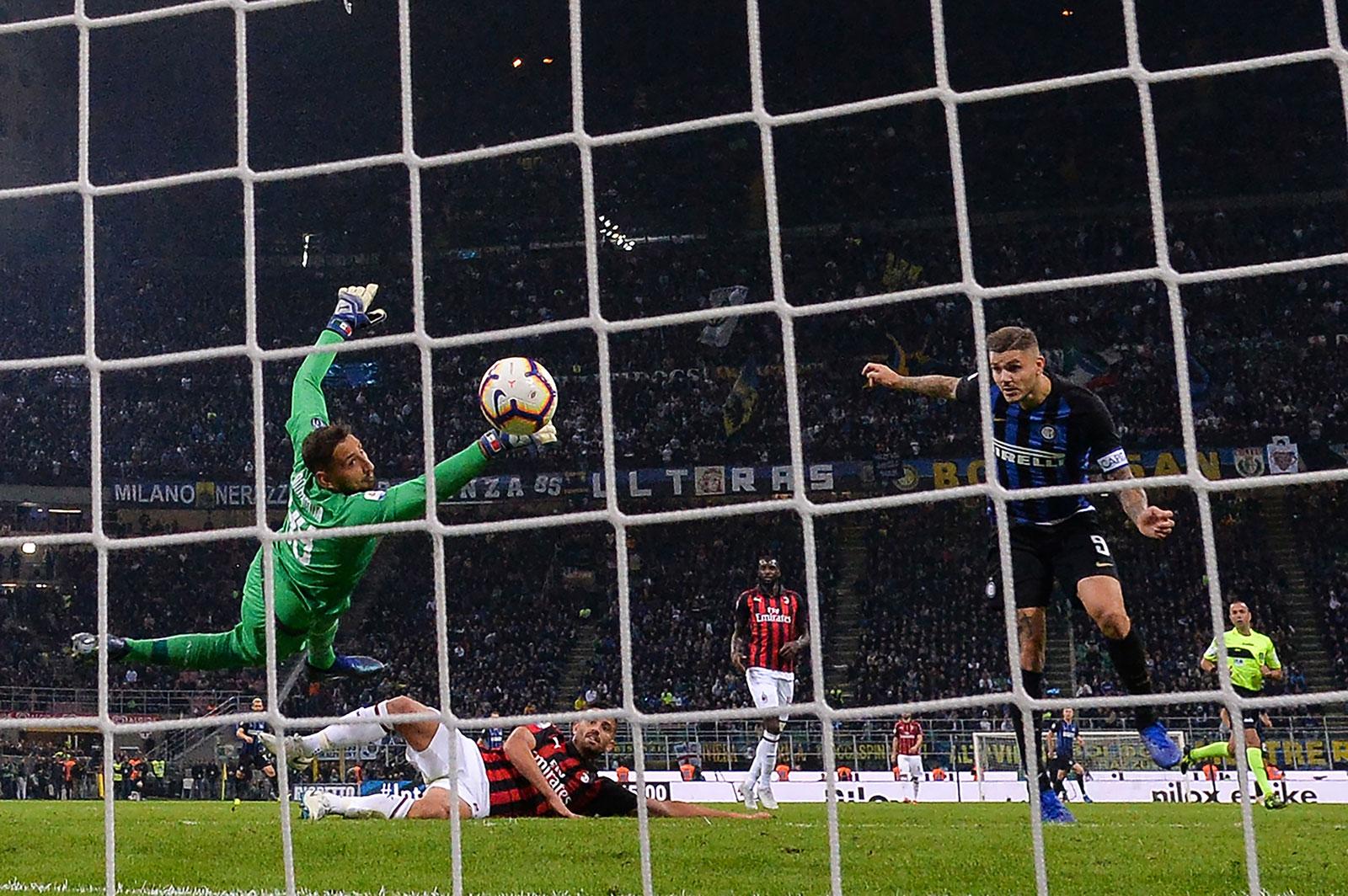 Mauro Icardi scoring past Gianluigi Donnarumma during Inter-Milan at Stadio San Siro on October 21, 2018. (MARCO BERTORELLO/AFP/Getty Images)