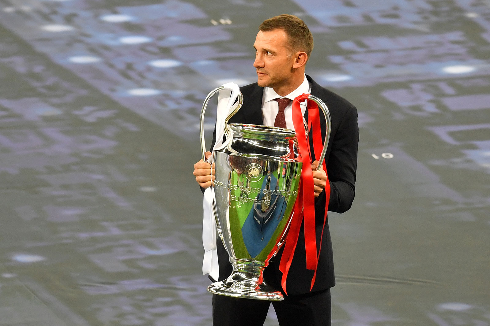 Former Ukrainian football player Andriy Shevchenko carries the trophy prior to the UEFA Champions League final football match between Liverpool and Real Madrid at the Olympic Stadium in Kiev, Ukraine on May 26, 2018. (Photo by Sergei SUPINSKY / AFP) (Photo credit should read SERGEI SUPINSKY/AFP/Getty Images)