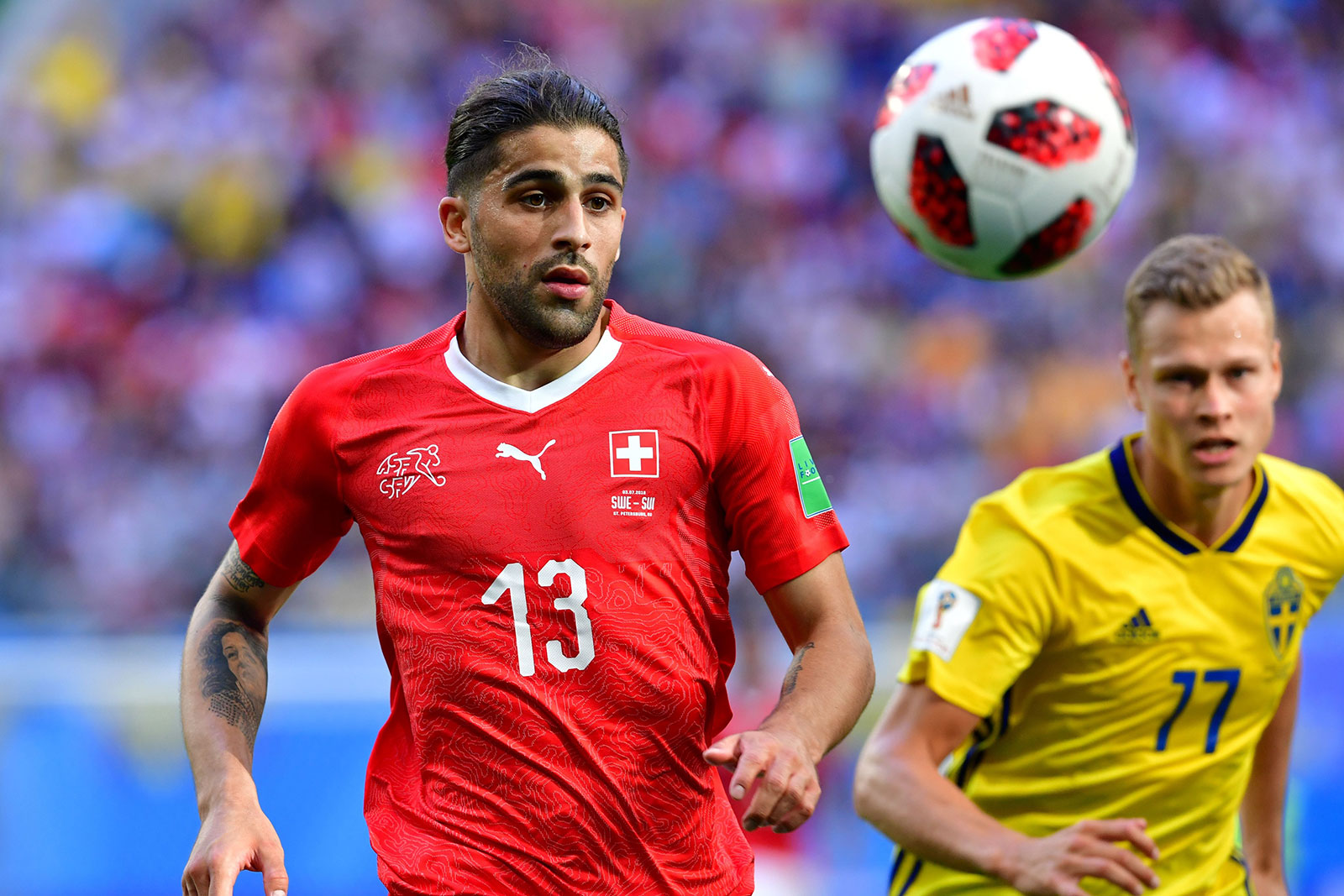 Ricardo Rodriguez and Viktor Claesson during the Sweden-Switzerland 2018 World Cup match at Saint Petersburg Stadium on July 3, 2018. (GIUSEPPE CACACE/AFP/Getty Images)
