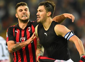 Alessio Romagnoli and Patrick Cutrone celebrating during Udinese-Milan at Stadio Friuli on November 4, 2018. (Photo by Alessandro Sabattini/Getty Images)