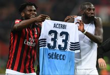 Franck Kessié and Tiémoué Bakayoko celebrating with Francesco Acerbi's jersey at the end of Milan-Lazio at Stadio San Siro on April 13, 2019. (MIGUEL MEDINA/AFP/Getty Images)