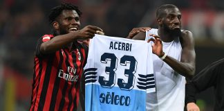 Franck Kessié and Tiémoué Bakayoko celebrating with Francesco Acerbi's jersey at the end of Milan-Lazio at Stadio San Siro on April 13, 2019. (MIGUEL MEDINA/AFP/Getty Images)