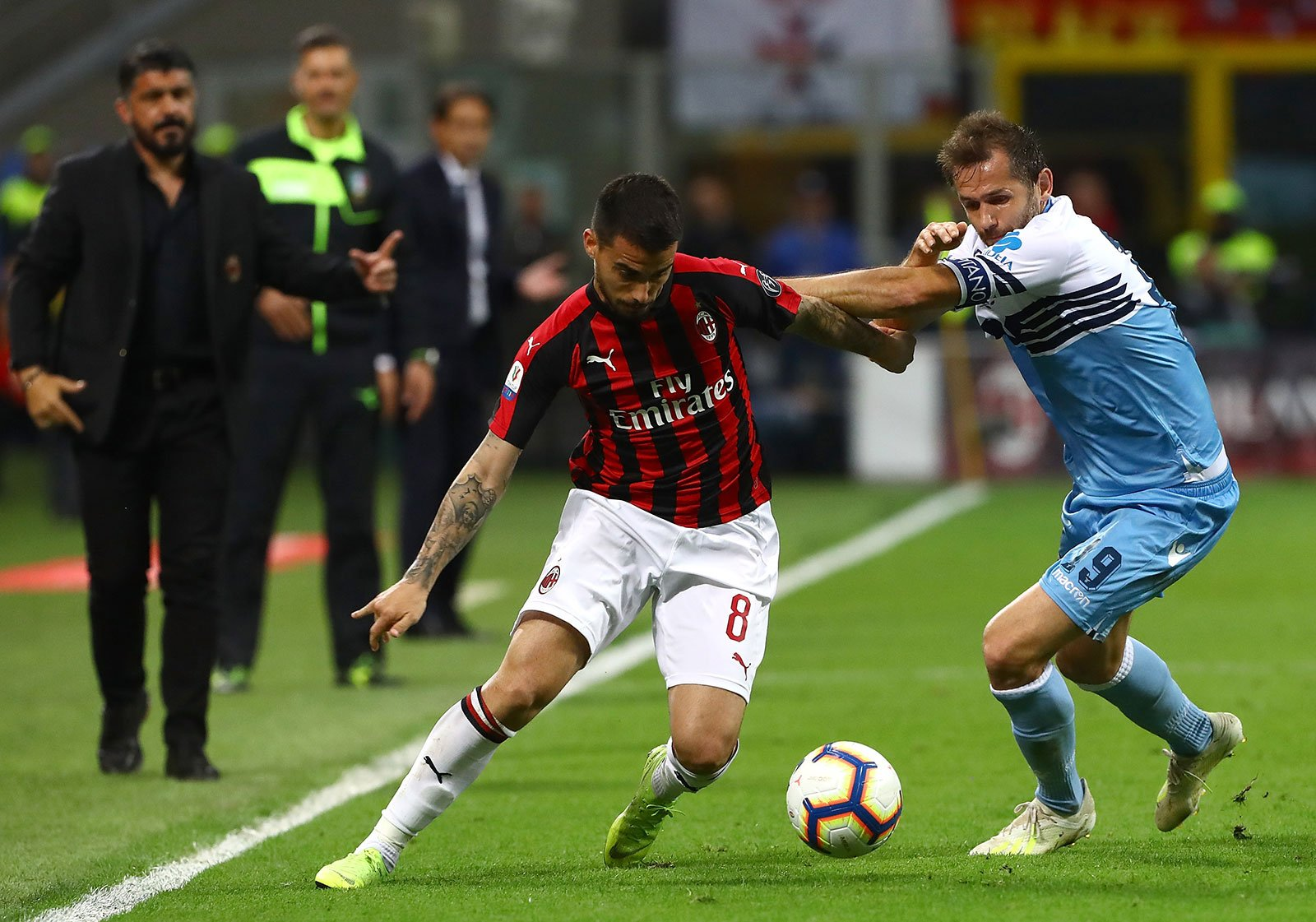 Suso and Senad Lulić during Milan-Lazio at Stadio San Siro on April 24, 2019. (Photo by Marco Rosi/Getty Images)